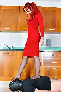 Redhead femdom wife teaches her wormy husband a lesson by trampling and kicking him