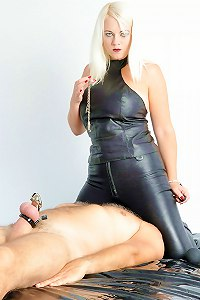 Blonde mistress teases and torments her chastity slave