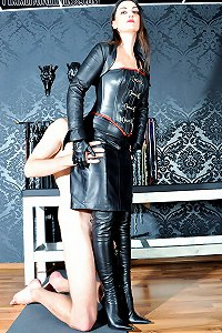 The Goddess of leather gives her slave the honour of worshipping her leather boots