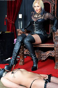 The lucky slave is made to worahip leather clad mistresse