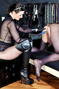 Dominatrix anally violated pantyhose boy slut