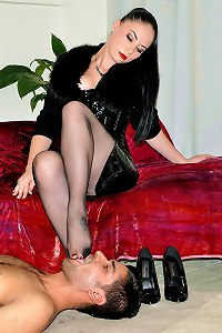 Cruel femme fatale brings her slave to tears by making him worship her smelly feet