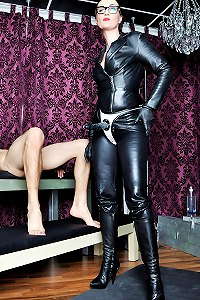 Mistress in leather outfit made her gimp suck and kiss her rubber strap-on cock and boots