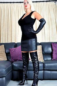 Leather clad mistress is waiting for you to worship and lick her boots