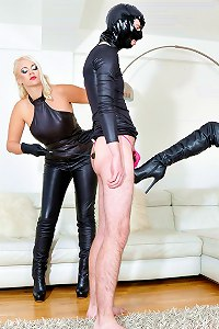Worthless gimp is kicked and ball busted by two leather clad dommes