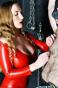 Mistress in tight red dress toying with male slave